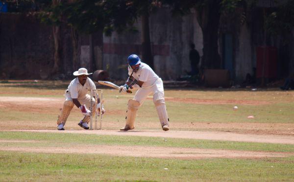 Men Playing Cricket photo