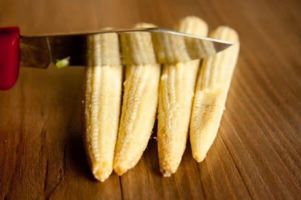 Cutting Baby Corn photo
