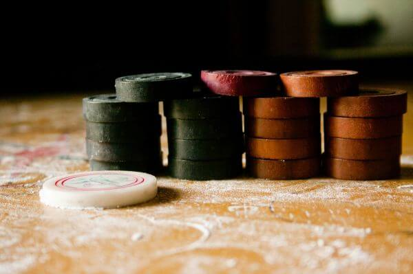 Carrom Coins And Striker photo