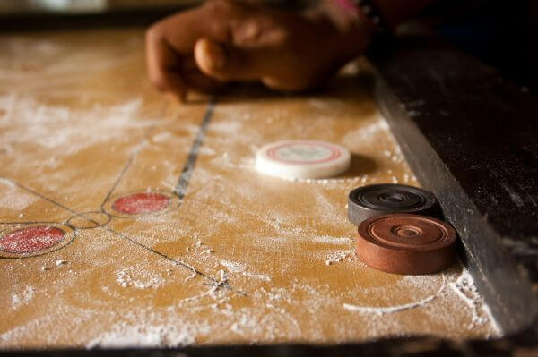 Striker Hitting Coins Carrom photo
