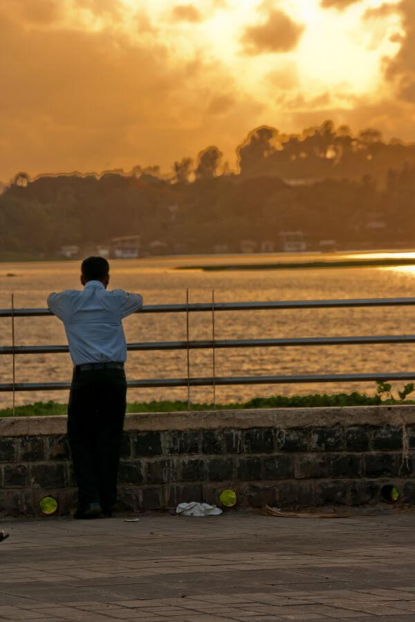Man Standing Alone Thinking photo