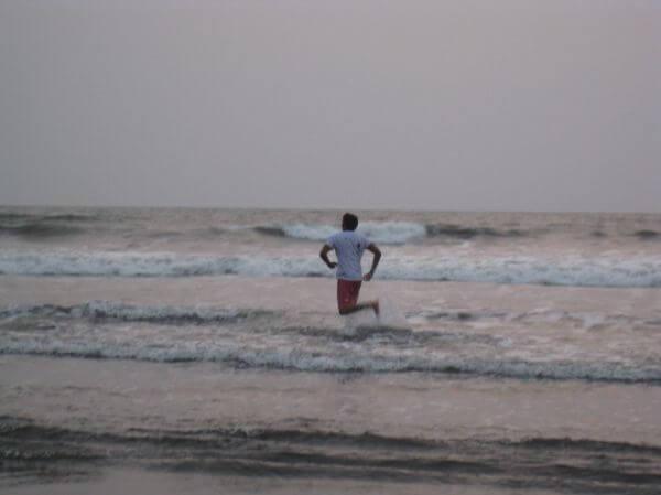 Man Running On Beach photo