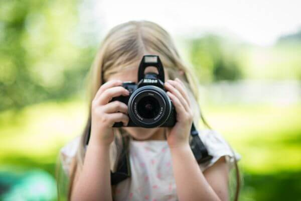 Girl taking a picture photo