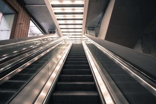 Escalators at a train station photo