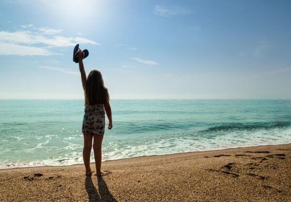 Happy girl at the beach photo