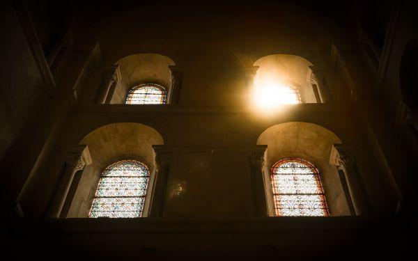 Sun peeking through church windows photo