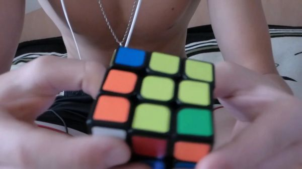 A guy with a rubik's cube  rubik's cube  cube video
