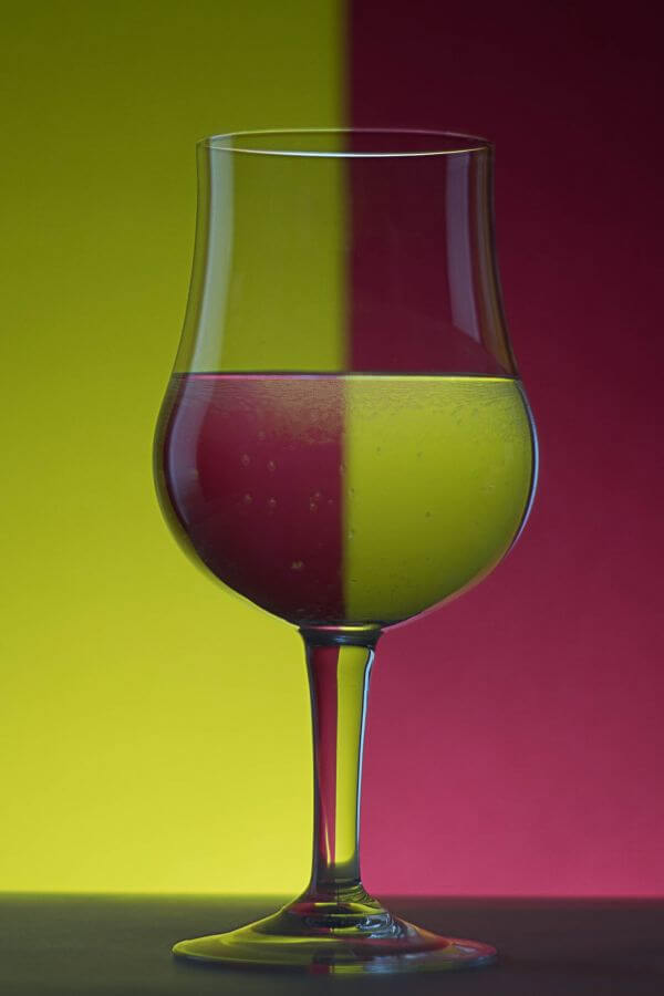 Beer Glass Against Colored Background photo