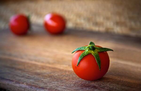 Tomatoes on Wooden Table photo