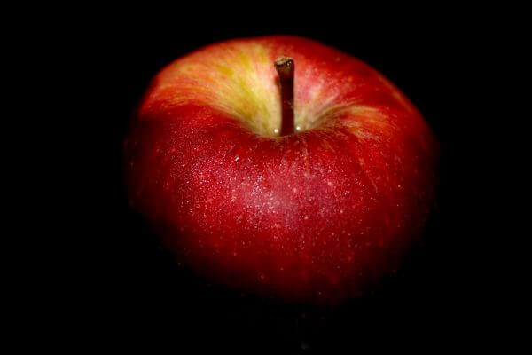 Apple Against Black Background photo