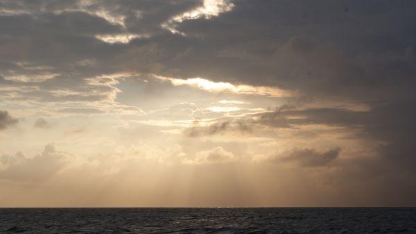 Sun breaks through clouds photo