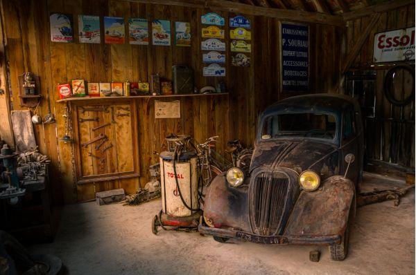 Old car in repair shop photo