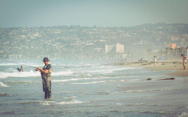 Man Fishing Fisherman Hat Beach Waves Sea photo