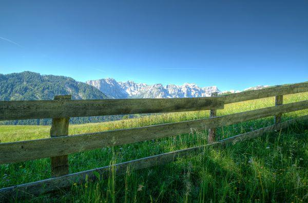 Green Fields Fence Mountain Blue Sky photo