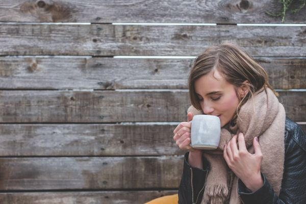 Woman Drinking Hot Coffee photo