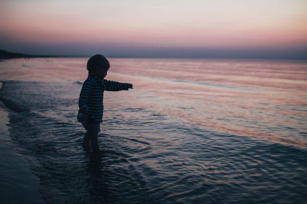 Child Boy Beach Sea Dusk photo