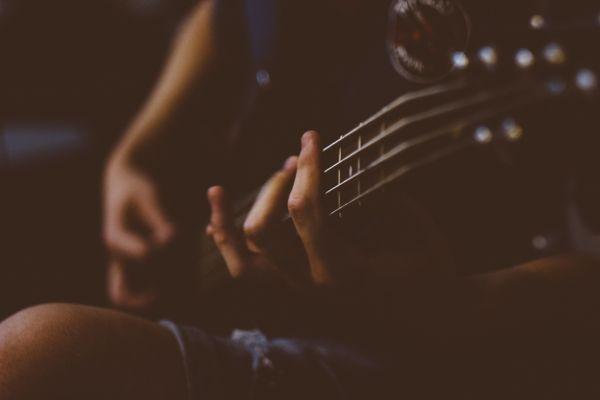 Closeup Playing Guitar photo