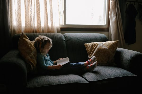 Small Child Girl Reading Book photo