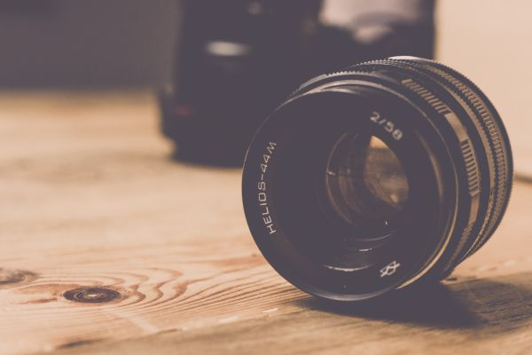 Camera Lens Wooden Table photo