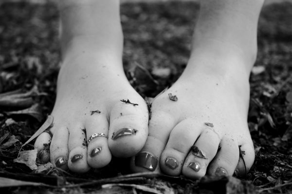 Woman Feet Black White Leaves photo