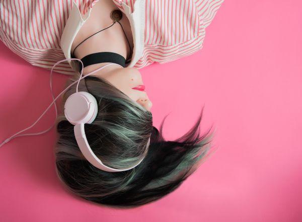 Woman Headphones Pink Background photo