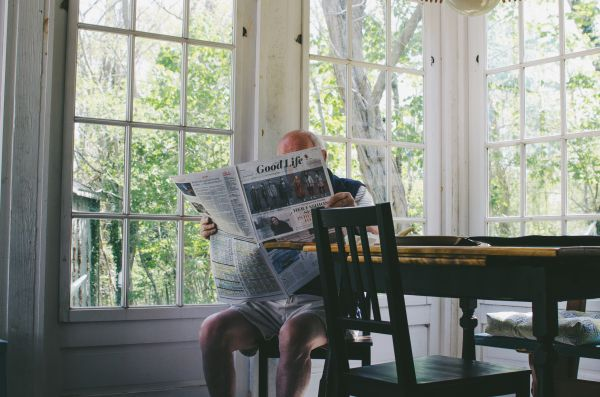Old Man Reading Newspaper Morning photo