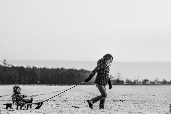 Woman Child Snow Sledge photo