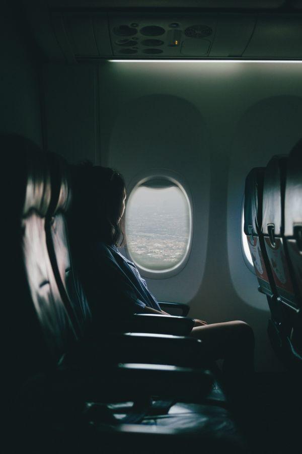 Woman Plane Window photo
