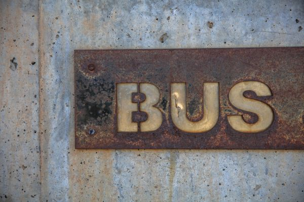 Rusty Bus Sign Wall photo