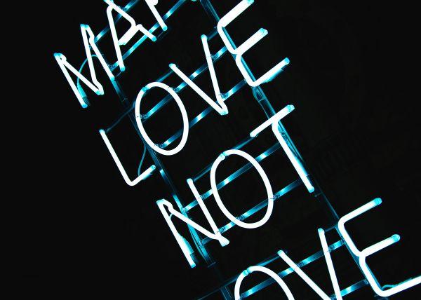 Make Love Not War Neon Sign photo