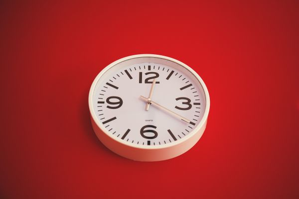 White Wall Clock Red Background photo