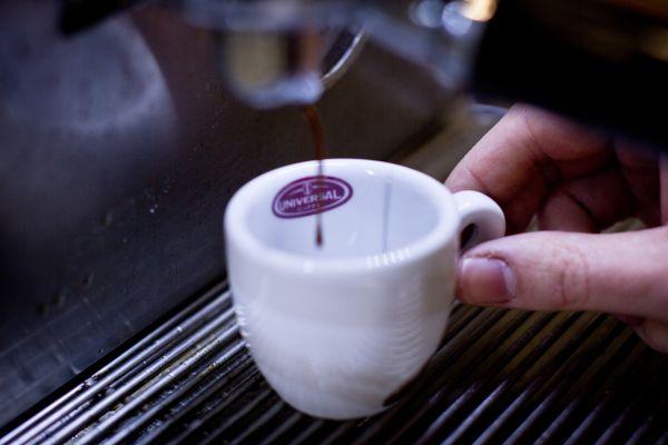 Pouring Espresso Coffee photo