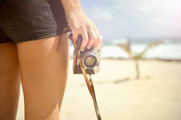 Woman on Beach and Vintage Camera photo