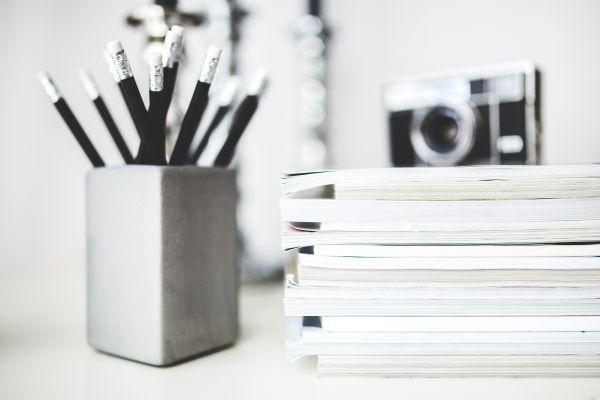 Desk With Pencils & Magazines photo