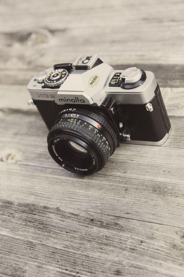 Minolta Camera on Wooden Surface photo