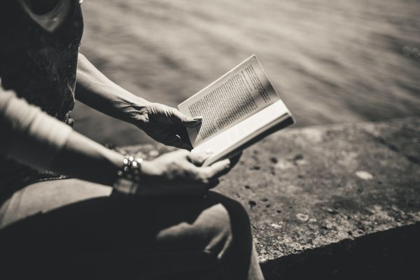 B&W Woman Reading Book in Park photo