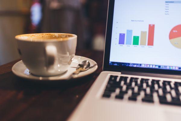 MacBook, Charts and Coffee photo