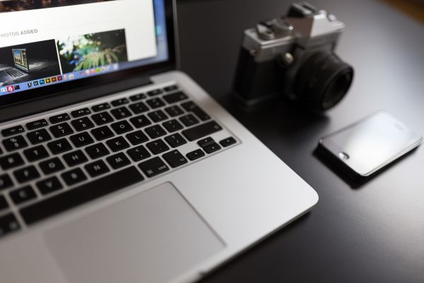 MacBook and Retro Camera photo