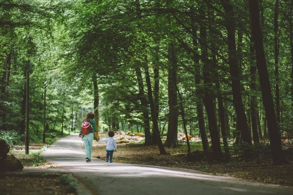 Woman and Child Walking in Park photo