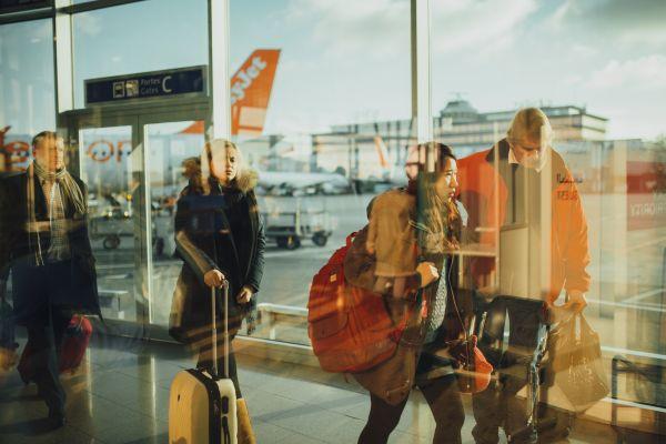 People Walking Through an Airport photo
