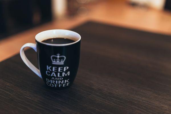 Black & White Coffee Mug on Desk photo