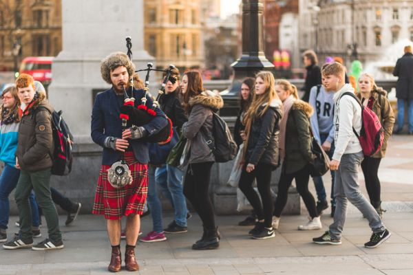 Playing Bagpipes on Crowded Street photo