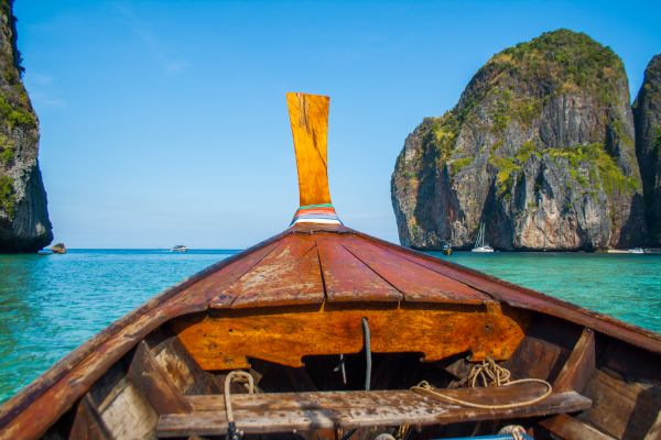 Rustic Row Boat on Clear Water photo