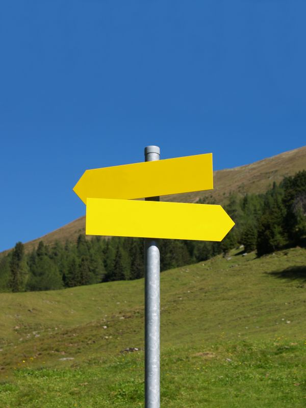 Yellow Signpost in the Mountains photo
