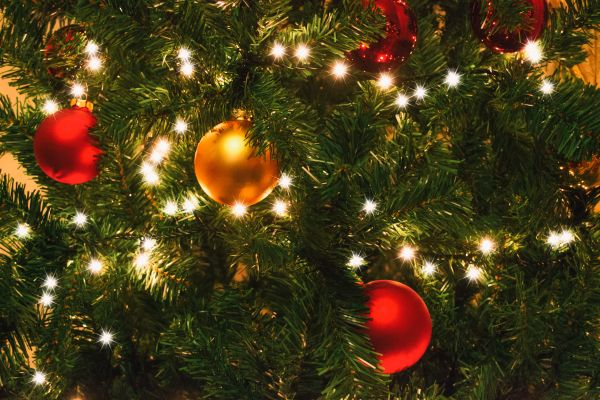 Christmas Tree Details with Lights and Colored Christmas Balls photo