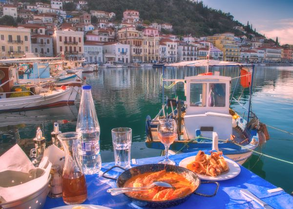 Sea Food By the sea with Gytheio Greek Location in the Backgound photo